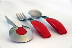 Image of specialist cutlery specifically made for people who struggle with standard cutlery.