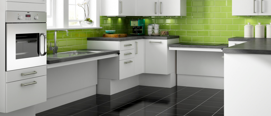 Image of a kitchen with lowered worktops, perfect for people who are wheelchair bound.